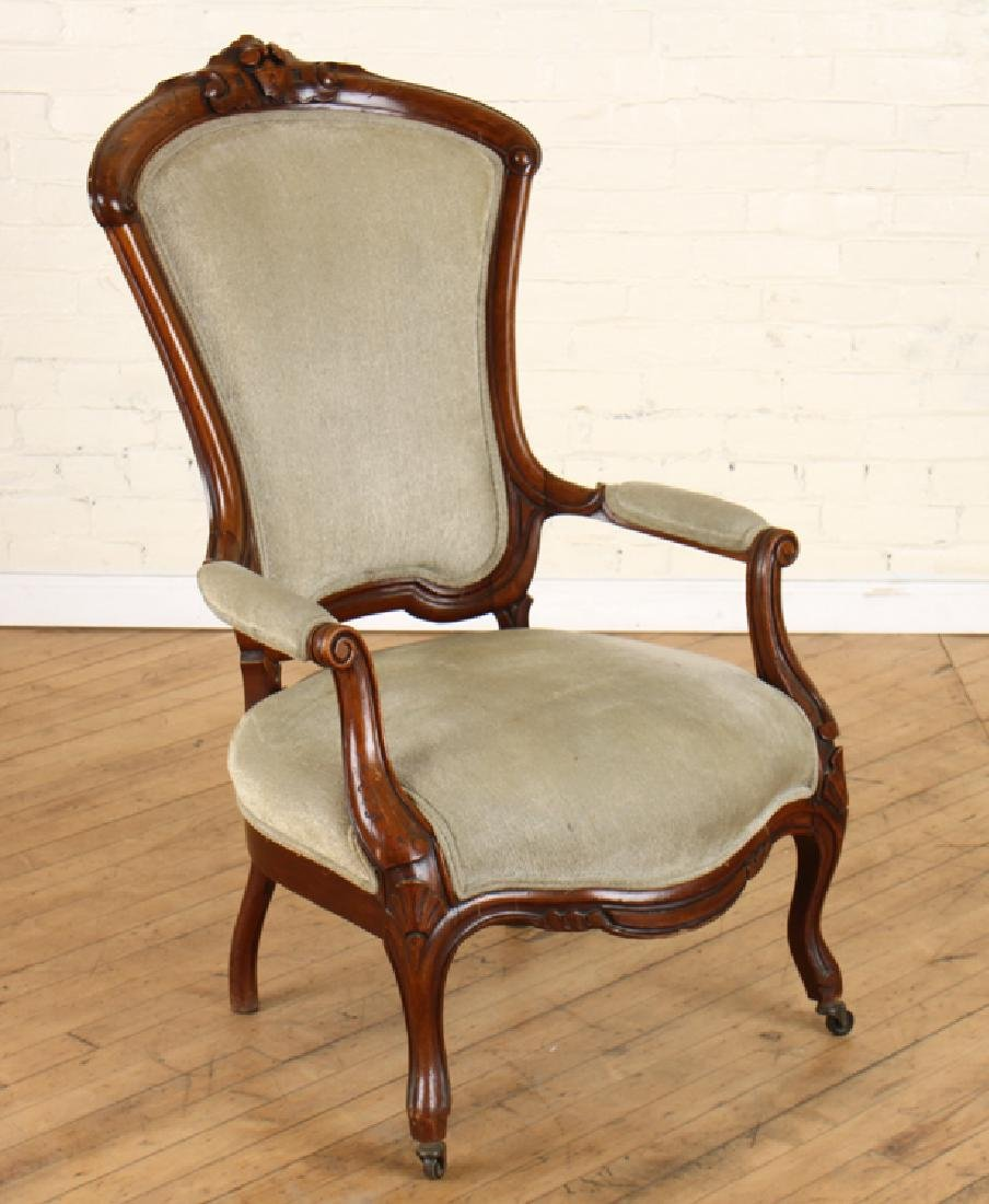 AMERICAN VICTORIAN CARVED WALNUT OPEN ARM CHAIR