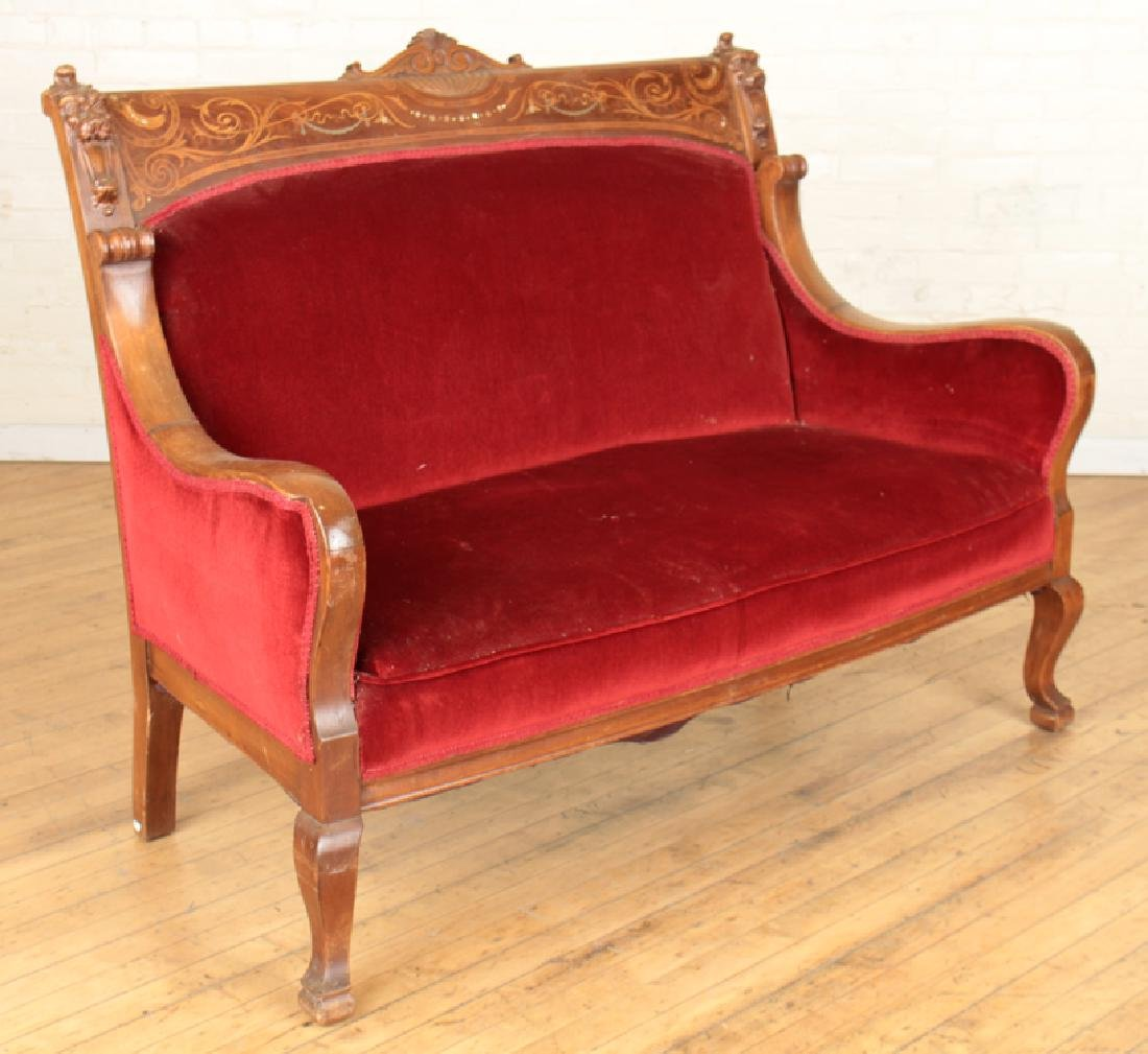 FIGURAL CARVED MAHOGANY SETTEE CIRCA 1900