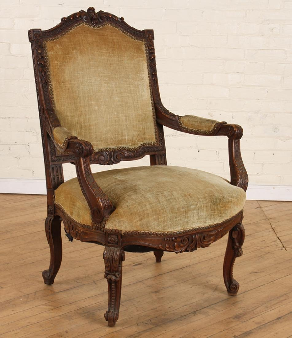LATE 19TH C. CARVED WALNUT OPEN ARM CHAIR