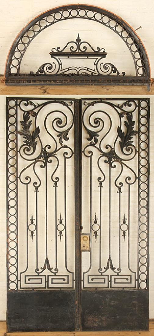 PAIR BLACK IRON GATES & ARCH FORM TRANSOM C.1920