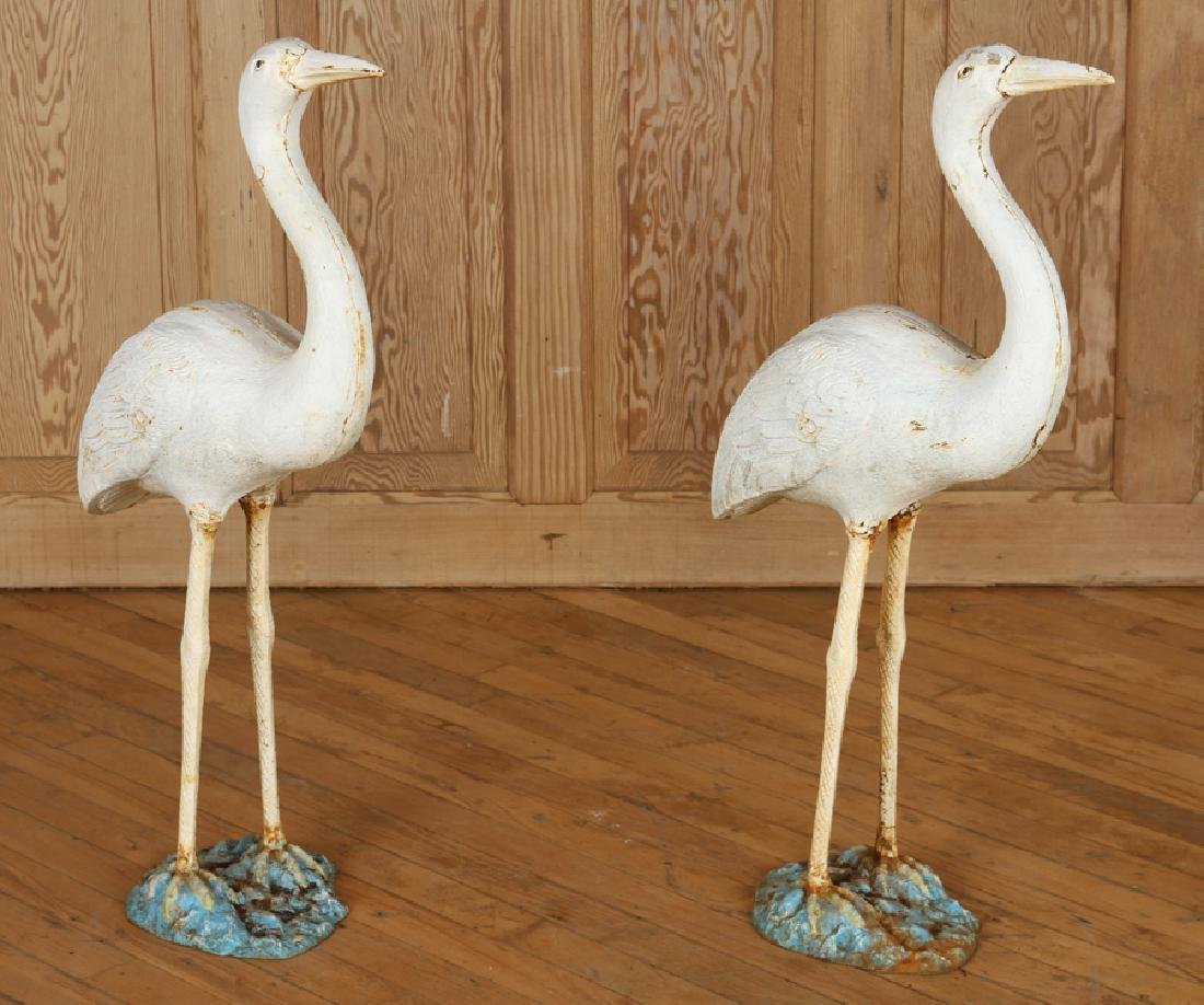 PAIR PAINTED CAST IRON CRANES ON BASES
