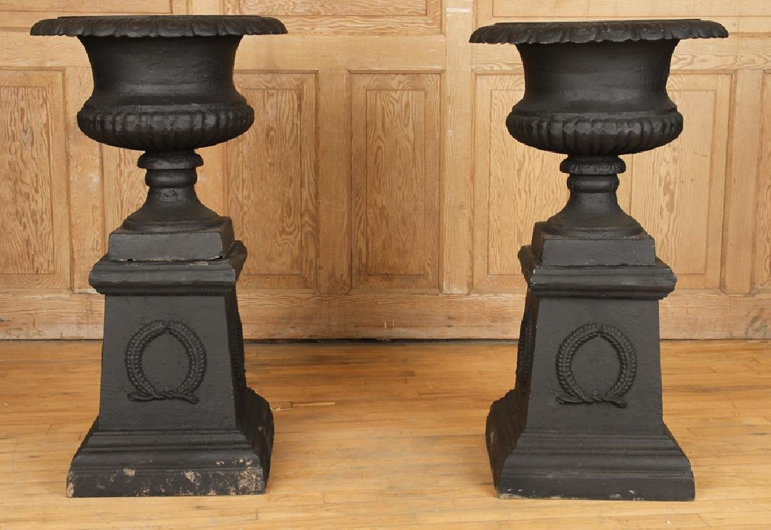 PAIR CAST IRON GARDEN URNS ON PEDESTALS