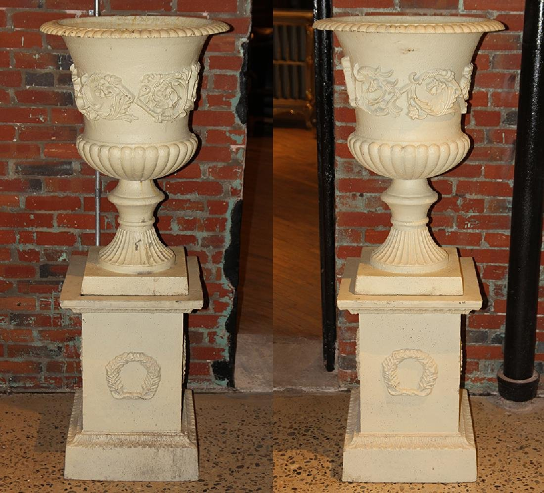 PAIR NEOCLASSICAL STYLE CAST IRON URNS