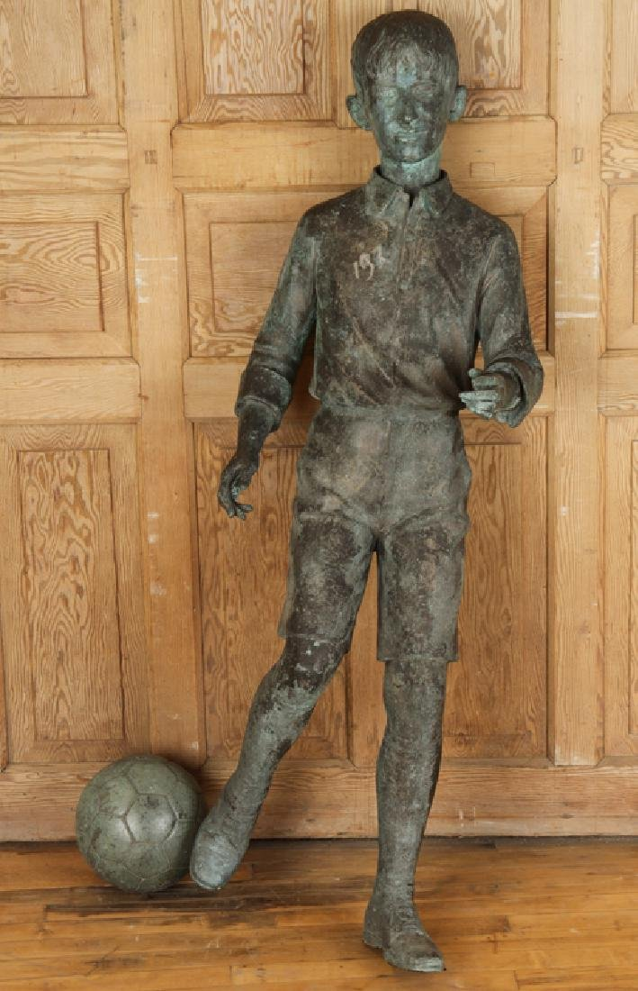 CAST BRONZE FIGURE OF BOY PLAYING SOCCER