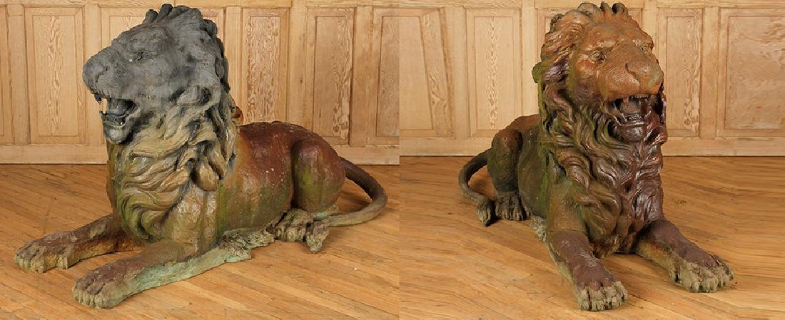 MONUMENTAL PAIR OF RECUMBENT BRONZE LIONS