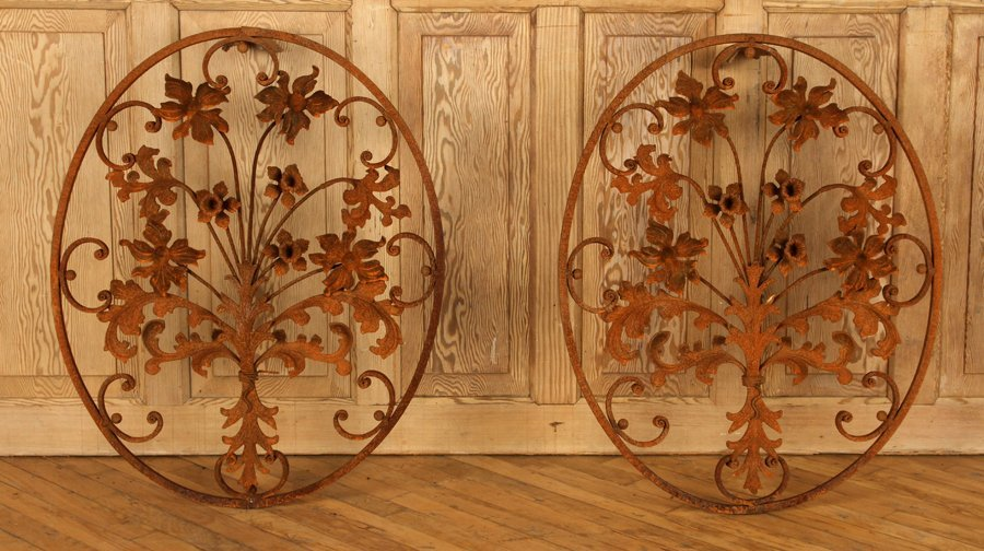 PAIR OVAL WROUGHT IRON WALL HANGINGS WITH FLOWERS