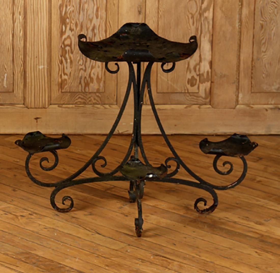 AN ANTIQUE WROUGHT IRON PLANT STAND