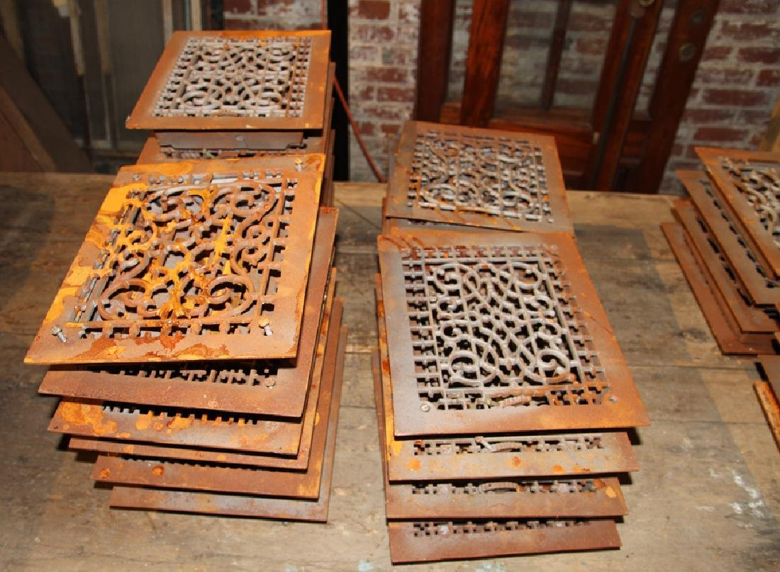 COLLECTION OF 22 ANTIQUE CAST IRON HEAT REGISTERS