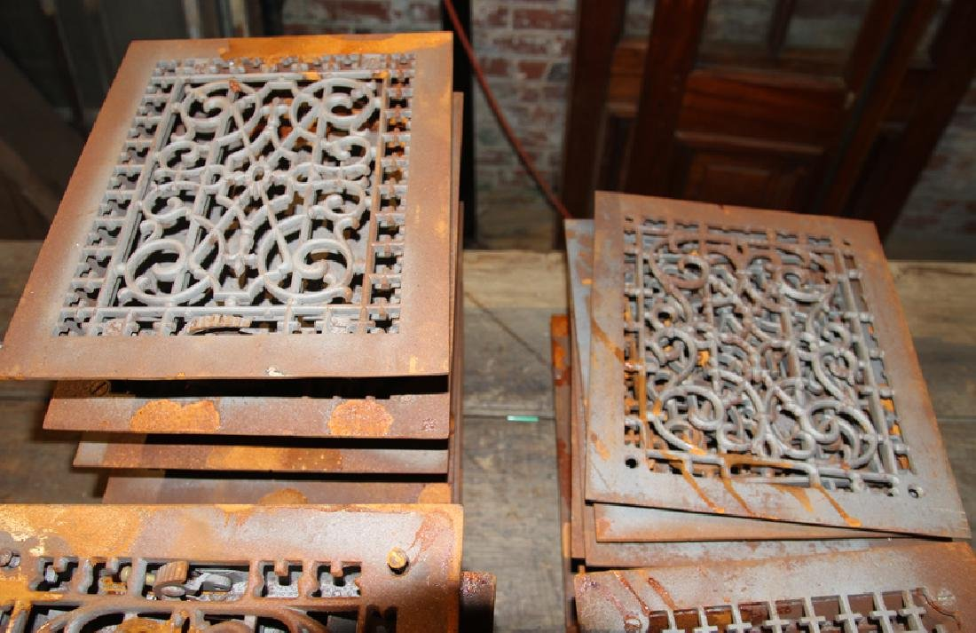 COLLECTION OF 22 ANTIQUE CAST IRON HEAT REGISTERS - 2
