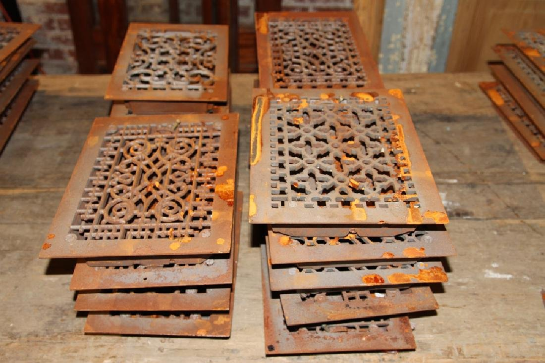 COLLECTION OF 18 ANTIQUE CAST IRON HEAT REGISTERS