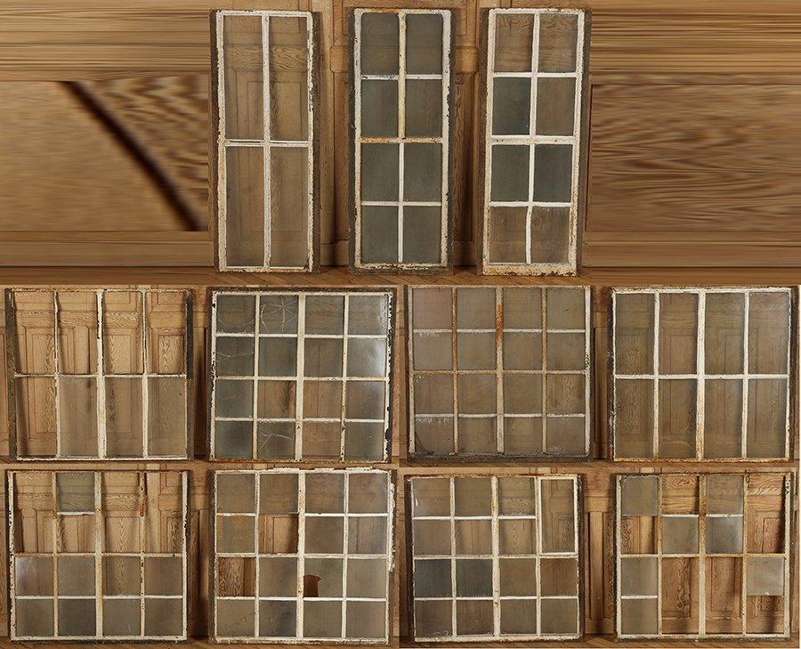 ELEVEN CAST IRON WINDOWS