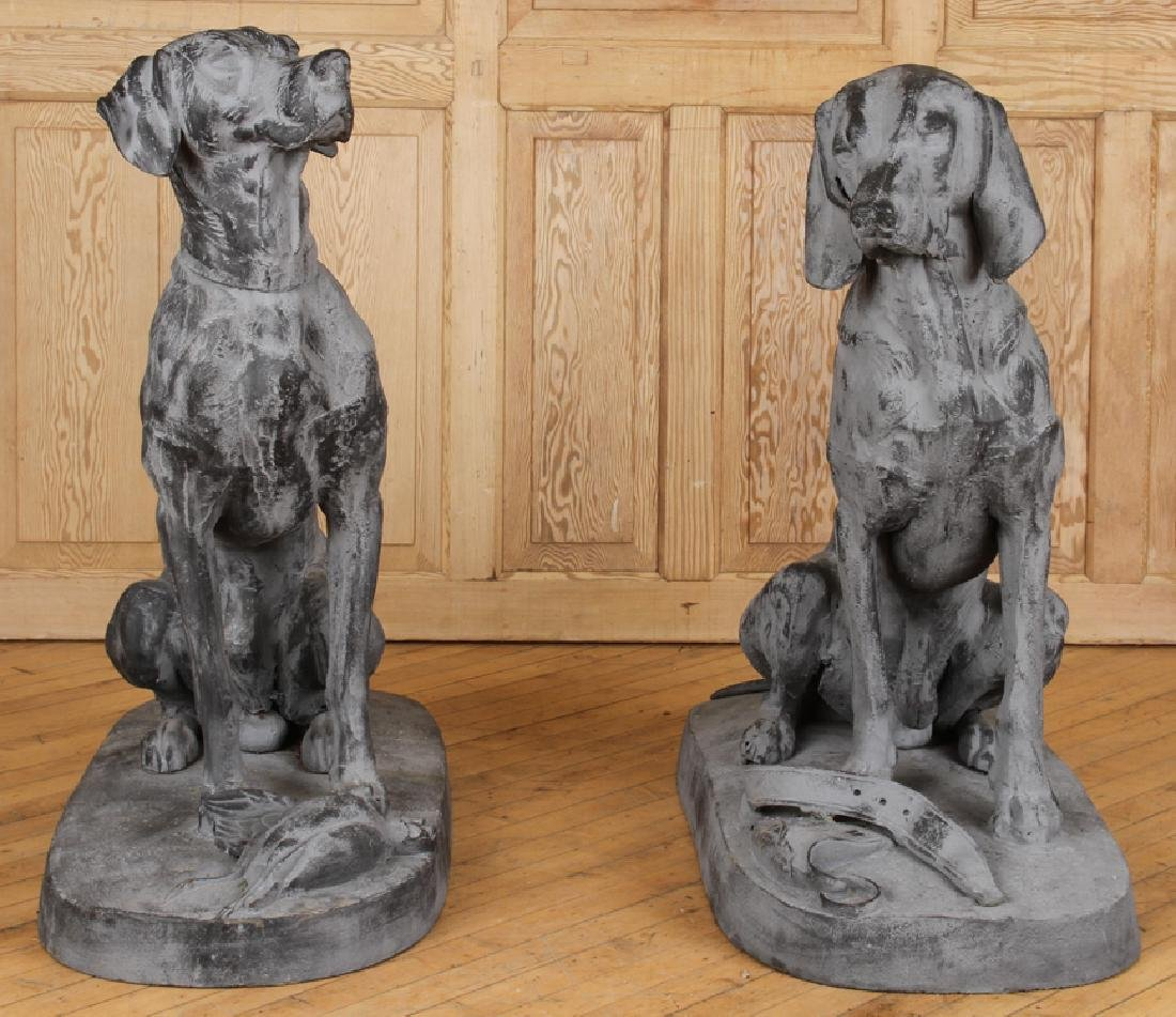 TWO STANDING CAST IRON DOGS