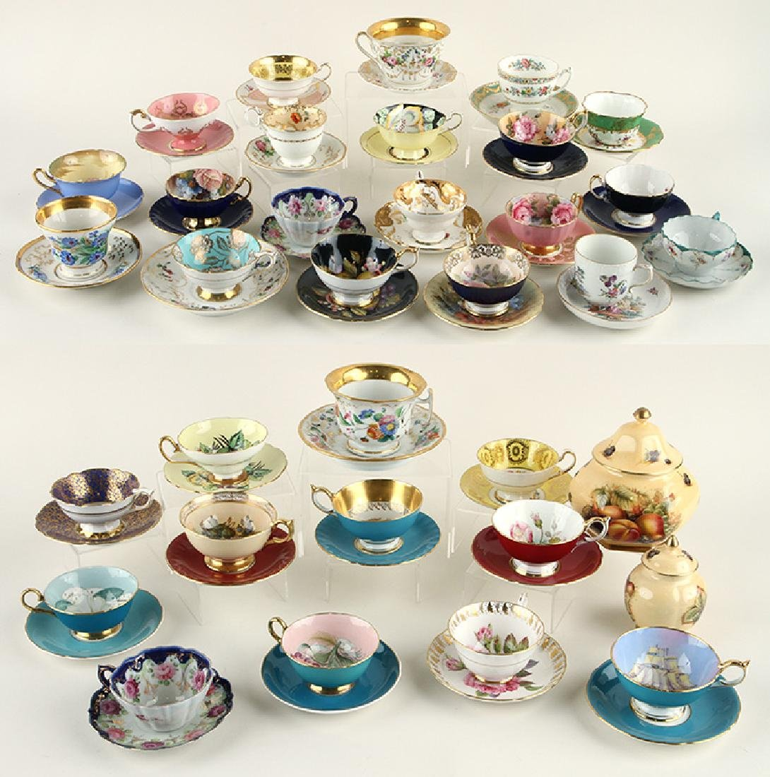 32 HAND PAINTED PORCELAIN TEA CUPS AND SAUCERS