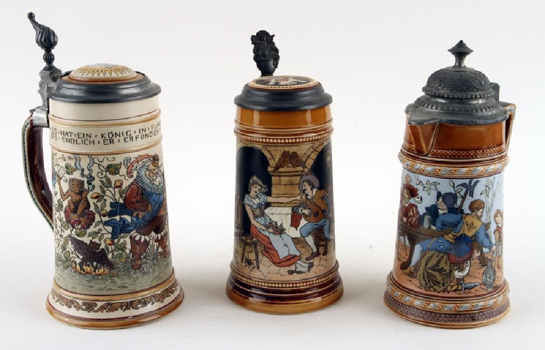 THREE GERMAN METTLACH LIDDED BEER STEINS