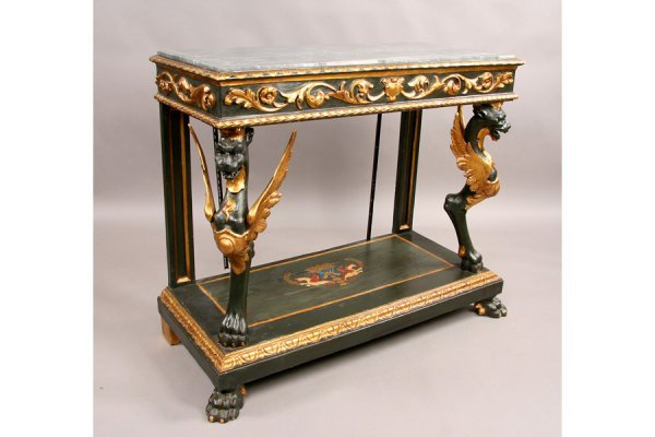 303: Highly carved gilt decorated marble top console