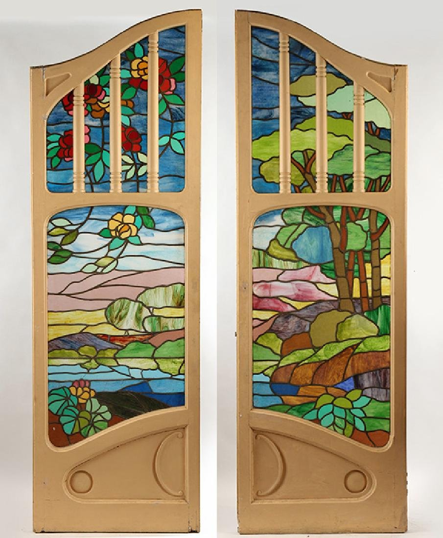 PAIR ARCHED WOOD DOORS WITH STAINED GLASS PANELS