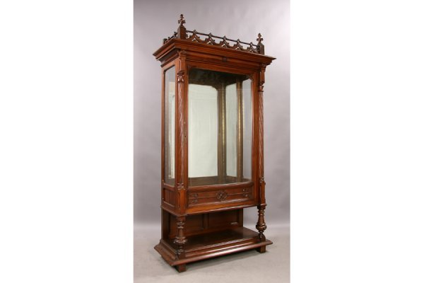 7: Antique carved walnut gothic vitrine