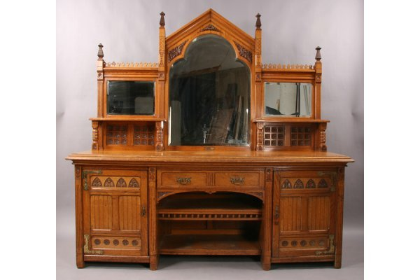 13: Antique carved oak gothic style sideboard