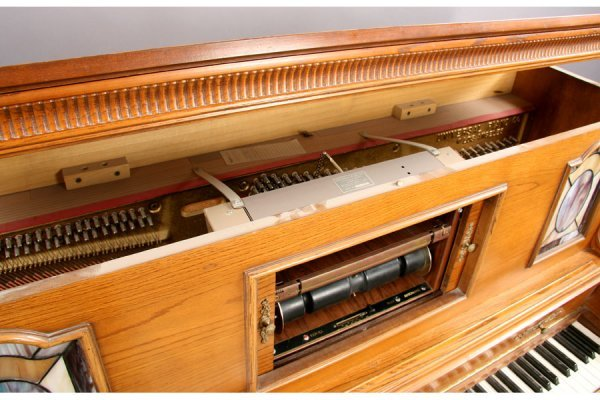 57: Universal carved oak griffin player piano and bench - 10