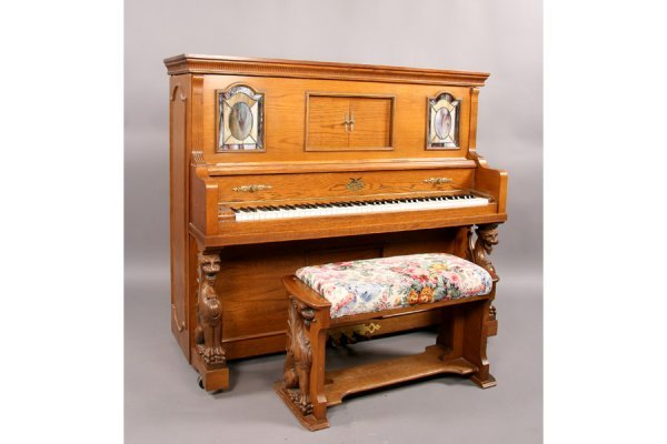 57: Universal carved oak griffin player piano and bench
