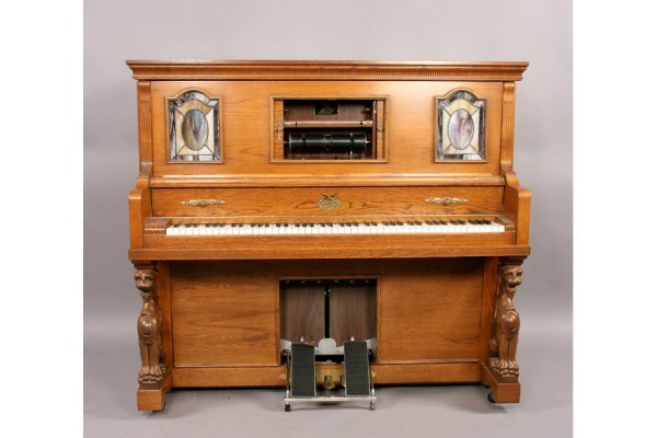 57: Universal carved oak griffin player piano and bench - 3