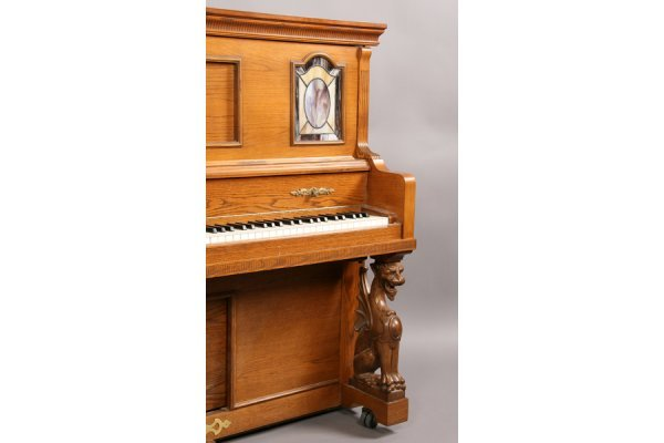 57: Universal carved oak griffin player piano and bench - 7