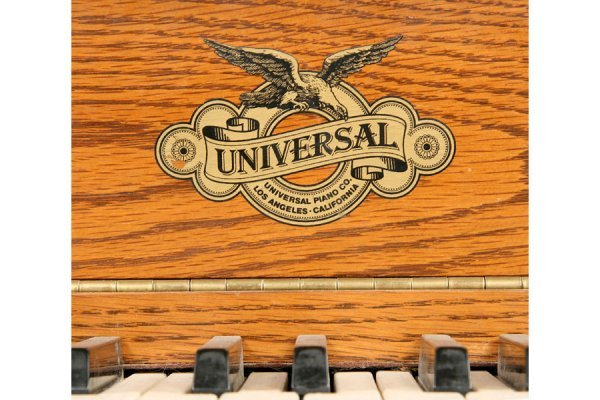 57: Universal carved oak griffin player piano and bench - 8
