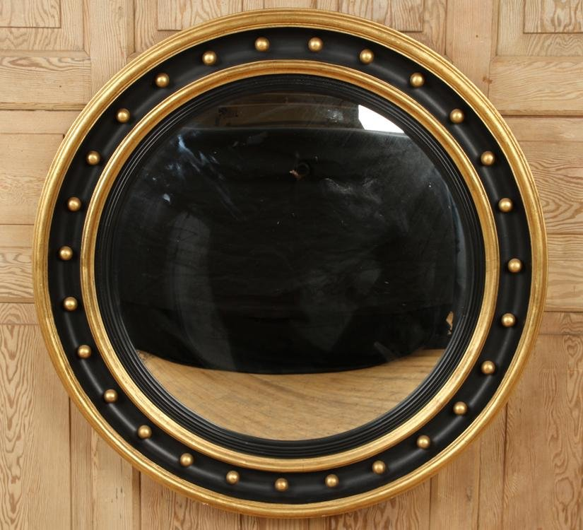LARGE ROUND GILT WOOD AND BLACK CONVEX MIRROR
