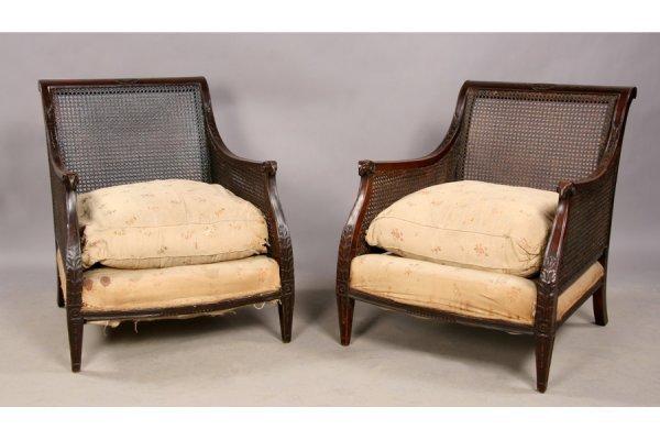 13: Pair mahogany Regency rams head library chairs