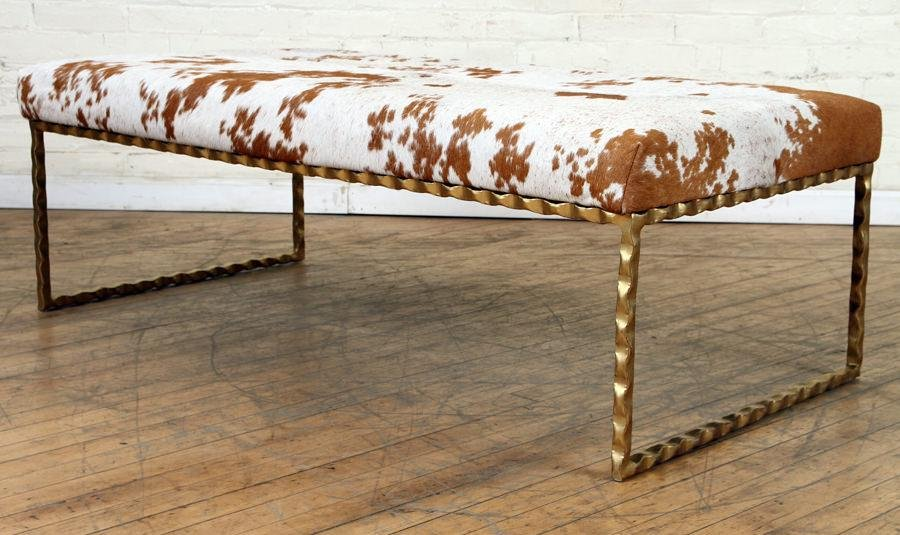 GILT IRON BENCH WITH COW HIDE UPHOLSTERED TOP