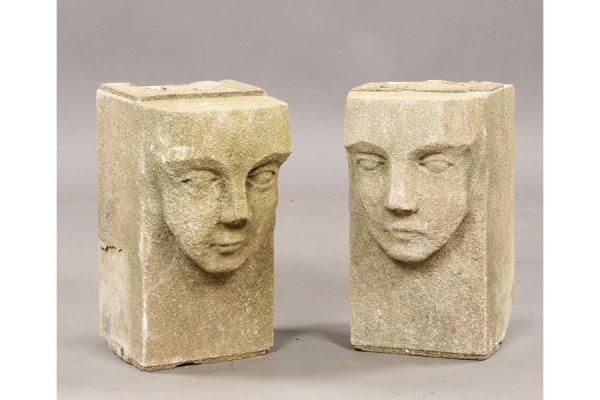 6: 2 cast stone figural corbels