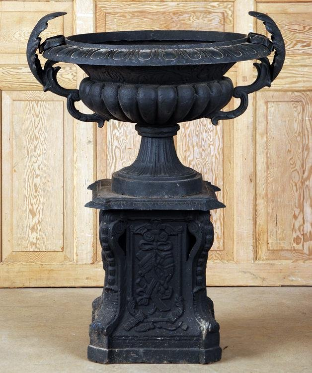 LARGE CAST IRON GARDEN URN WITH FOLIATE HANDLES