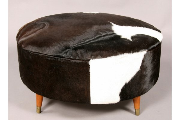 10: MODERN ROUND OTTOMAN UPHOLSTERED IN COWHIDE