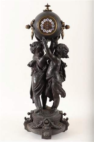 FRENCH FIGURAL CLOCK IN FORM OF TWO PUTTI C.1890