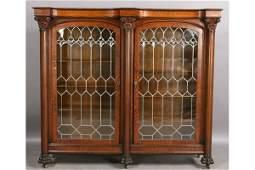 105: AMERICAN VICTORIAN CARVED OAK BOOKCASE GLASS DOOR
