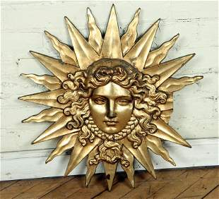 GOLD PAINTED STARBURST FIGURAL WALL SCULPTURE