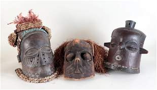 THREE AFRICAN CARVED WOOD TRIBAL MASKS