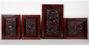 FOUR CARVED WALNUT CABINET DOORS C.1910