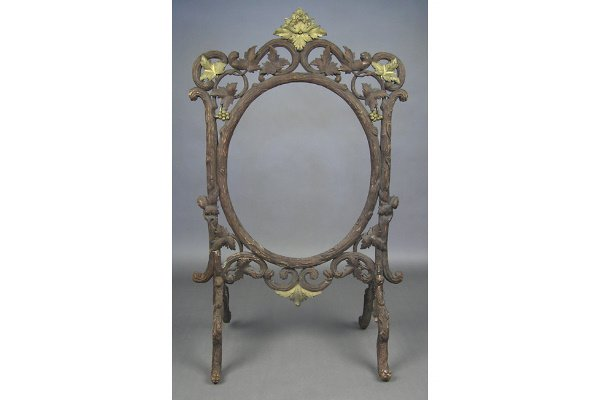 50101004: UNUSUAL BLACK FOREST CARVED WOOD FIRESCREEN.