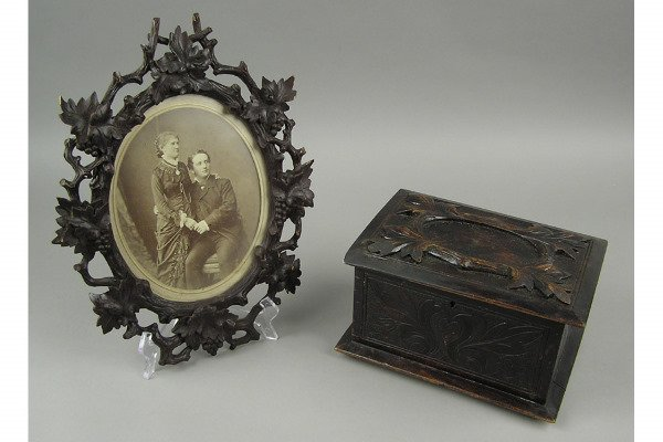 50101010: BLACK FOREST FRAME ALONG WITH A CARVED BOX.