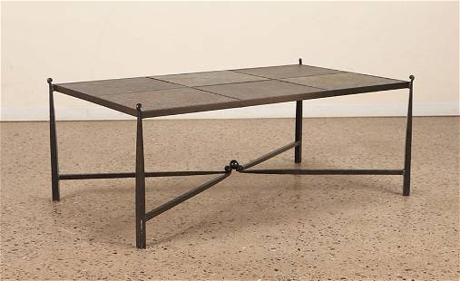 A WROUGHT IRON AND STONE TOP COFFEE TABLE