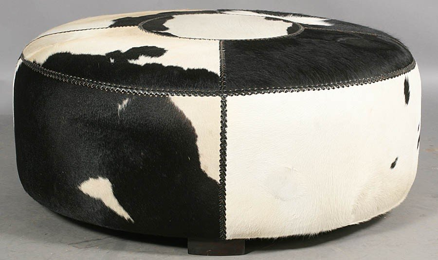 497: MODERN ROUND COWHIDE UPHOLSTERED OTTOMAN