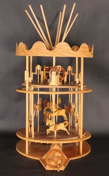 22: CARVE WOOD 2 TIERED TOY CAROUSEL