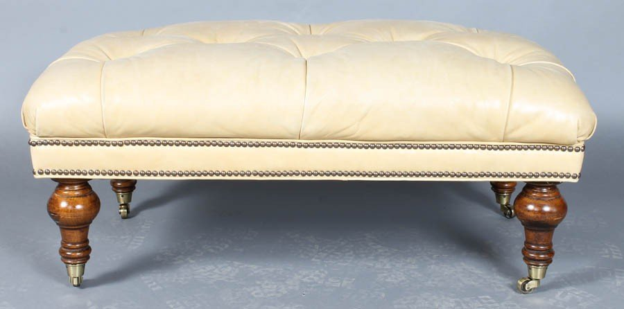 10: LEATHER UPHOLSTERED TUFTED OTTOMAN