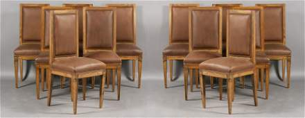 207A: Set twelve French oak leather upholstered dining
