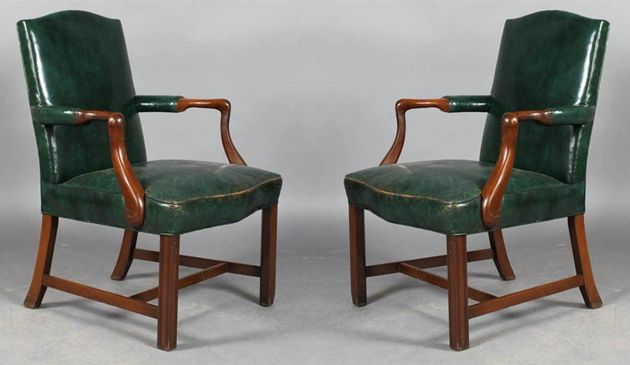 13A: A pair of labeled Kittinger leather arm chairs