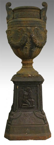 78A: Oversized two part cast iron urn and pedestal.