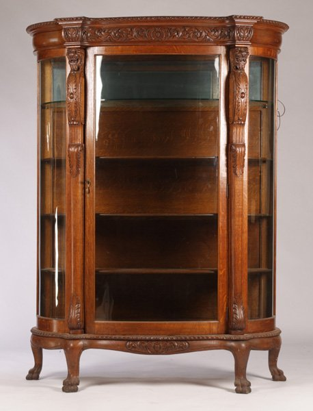 A GOOD TIGER OAK BOWFRONT CHINA CABINET C. 1890