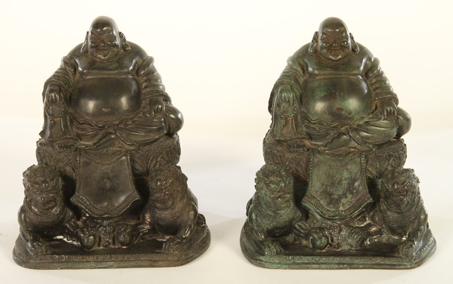 BRONZE BUDDHAS FLANKED BY LIONS