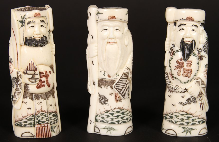 A GROUPING OF 3 FAUX IVORY DECORATIVE OKIMONO